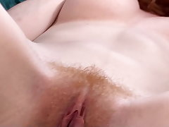 Hairy pussy Abby Rain uses a vibrator to orgasm