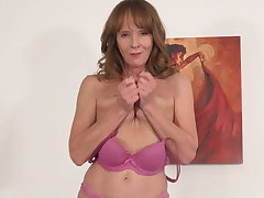 Fit grandmother fucks her old pussy