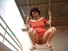 Depraved housewife indecisiveness on a swing outdoors